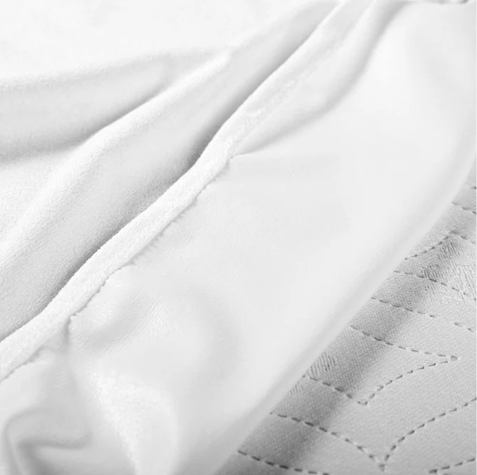 Наматрасник водонепроницаемый прямоугольный  для кроватки (120х60 см) белый